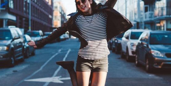 Happy Young Woman Jumping In New York