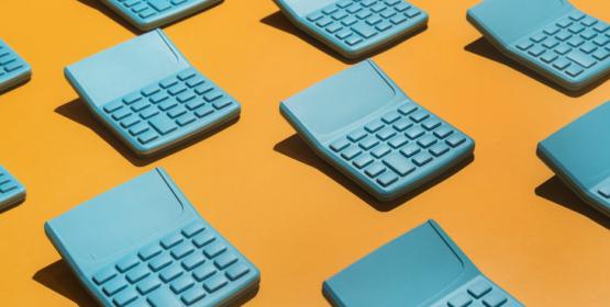 Blue Pocket Calculators On Orange Background.