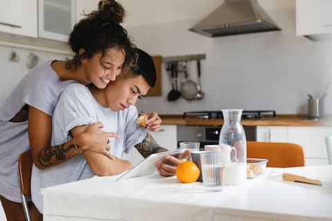 Young Couple Using The Digital Tablet Together At Home