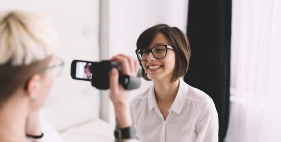 Happy Young Women Shooting Home Video
